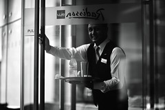 Paul Ka Batcha (N A Y E E M) Tags: paul polash waiter bartender candid portrait smile evian water bottle ramadan afternoon lobby hotel portbar radissonblu chittagong bangladesh availablelight