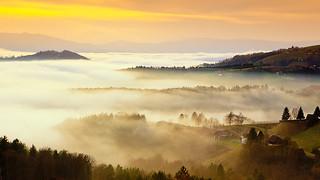 Misty mountains blazed with light