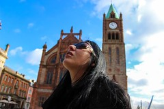 Nina - Faces - Derry Guildhall (seanfderry-studenna) Tags: nina face protrait long dark hair brunette sunglasses blue sky white clouds derry doire londonderry guildhall building tower clock time architecture black clothes throat neck skin pink lips contrast pose posed posing woman female girl lady beauty beautiful gorgeous stunning charming people persons outdoor outside ireland irish eire eireann serb girlfriend fiancee wife married expression