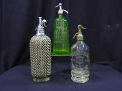 HOUSEHOLD:  Selection of seltzer bottles.