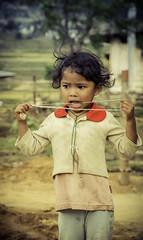 Apprehension (Baron Reznik) Tags: portrait girl face fashion vertical hair kid clothing model child bhutan thimpu himalaya ethnic everydaylife himalayas 頭髮 不丹 colorimage 걸 himalayanrange 服装 소녀 모델 어린이 옷 얼굴 drukyul canon24105mmf4lis 털 kingdomofbhutan thimphudistrict landofthethunderdragon འབྲུག་རྒྱལ་ཁབ་ 부탄 འབྲུག་ཡུལ་ भुटान ཐིམ་ཕུ་རྫོང་ཁག 廷布宗 팀부현 abodeofthesnow teoprongchu