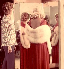 I check it out in the mirror (Sugarbarre2) Tags: mature woman baby mistress red fur image flash fun party formal minolta s mom granny fashion reflection white me