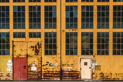 alameda-054.jpg (Yvonne Rathbone) Tags: 1855mmf3556gvr nikkor nikon abandoned industrial orange pattern rust warehouse windows flickrloungeweekly repetition technical repitition