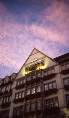 Sunset on Munich (greendarkroom) Tags: agfact diafilm greendarkroom munichatnight mnchen oktoberfest scans wiesn2016 lights bokeh fair people sunset light black blue munich cultur germany night