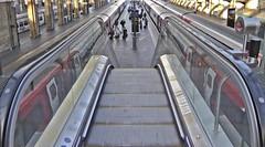 Escalator down (WLE 17) Tags: escalator movingstaircase platform trains travel railroad kingscrossrailwaystation
