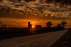 Sunsetting over Iowa (Thomas DeHoff) Tags: iowa sunset clouds road farm sony a700