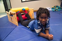 Girl Hugging Squeeze Machine Occupational Therapy Gym BRAINS Grand Rapids January 21, 2016 20 (stevendepolo) Tags: brains grandrapids hugging squeeze machine occupationaltherapy training core gym learningdisability lourdie