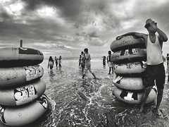 coxs bazar sea beach (riasat rakin) Tags: coxsbazar bangladesh beach travel sea cloud blackandwhite people water tubes
