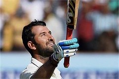 Rajkot: Indian batsman Cheteshwar Pujara celebrates after completing his century on the third day of the first Test match against England. (legend_news) Tags: rajkot indian batsman cheteshwar pujara celebrates after completing his century third day first test match against england