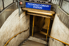 "Stairs Leading To The Piccadilly Circus Station - London, Englan (Photographie Alexi ""Alvin"" Dagher Photography) Tags: 2016 architecture attraction britain british city cityofwestminster commercial england english entrance europe famous goingdown interest intersection junction landmark ledge london lookingdown metal neon nopeople old outdoor piccadillycircus place rails red scene sign square stairs steps street theatreland ticketssale tourism tourist traffic transit travel tube tubestationentrance uk underground urban welllit west yellow ©alexidagher"