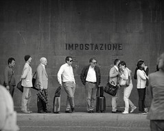 Lined up (p2-r2) Tags: street people blackandwhite italy film station rollei train florence nikon retro line queue 100 bags fa nikkor105mmf25ai impostazione