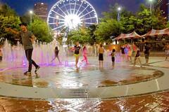 Kids of All Ages Play in Olympic Fountain (tvdflickr) Tags: atlanta playing water fountain kids georgia nikon df ferriswheel atlantageorgia nikondf centennialolympicfountain
