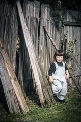 Child (Mariasme) Tags: child fence backyard hanabutterdays grass gamex2 family