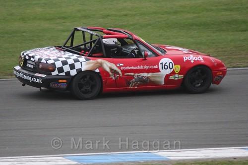 Mazda MX5s racing at Donington, October 2015