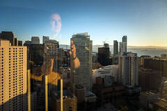 37 floors above sea level. (Cynthia E. Wood) Tags: sanfrancisco morning november selfportrait reflection cityscape skyscrapers sfmoma sanfranciscoca ghostly atwork downtownsanfrancisco goldenhour sfbay picturewindow windowreflection 2015 37thfloor ghostinthemachine lumixlx7 cynthiawoodphotography wwwcynthiawoodphotocom cynthiaewood 20151104cynthiawoodphotop1080219 fromthepresidentialsuite