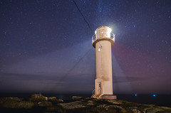 Late night relaxation (calmingechoes) Tags: ocean lighthouse night coast nikon outdoor nightsky