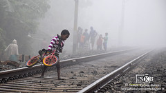In search of right track in the wintry morning (Suman Kalyan Biswas) Tags: morning portrait india nature childhood bicycle fog bicycling outdoor portraiture littleboy railwayline bengali westbengal foggymorning railline boychild childportraiture wintrymorning bethuadahari khidirpur kshidirpur nakashipara