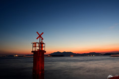 Direction (Jethro ~ C.P.C) Tags: sunset direction signal cross sea hongkong hkg hk magic hour asia coast orange blue