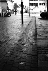 Hometown (Nikon F801) (stefankamert) Tags: stefankamert hometown black blackandwhite blackwhite noir noiretblanc mood perspective dof blurred nikon nikonf801 f801 n8008 voigtlnder ultron ilford hp5 place city street town analog film tones