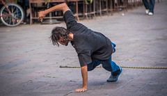 2016 - Mexico - San Luis Potosi - One Hand & Foot Stand (Ted's photos - Returns late December) Tags: 2016 cropped mexico nikon nikond750 nikonfx sanluispotosi tedmcgrath tedsphotos tedsphotosmexico vignetting male man dancing streetscene street earring bokeh beard badhair badhairday