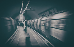 Clapham North Underground London by Simon & His Camera (Simon & His Camera) Tags: london blur underground tunnel city monochrome blackandwhite bw composition indoor lines passage simonandhiscamera tube urban vignette