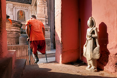 Leg. Bodhgaya, India (Marji Lang Photography) Tags: door travel pink light orange india man color composition temple one buddha buddhist indian leg documentary atmosphere monk buddhism scene bouddha holy handicap doorstep pilgrim oneperson bodhi amputation ambiance bouddhisme bihar oneman buddhistmonk handicaped bodhgaya mahabodhi travelphotography bodhitree handi oneleg republicofindia amputed ef247028l indiansubcontinent mahabodhitemple canoneos5dmarkii travelanddocumentaryphotography marjilang mahabodhimahaviharatemple