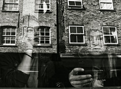 Reflections in Brick (Lane) (Becky Frances) Tags: architecture blackandwhite bricklane beckyfrances city candid england eastlondon eastend girl london lensblr olympus reflections streetphotography shoreditch urban uk 2015 cerealkillercafe