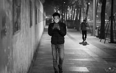 Magical (kiatography1) Tags: china street city blackandwhite man monochrome face mobile architecture composition town interesting exposure technology hand phone unique country teenagers teens olympus using frame mobilephone chengdu column lit framing brightness handphone scapes omd teenage youngsters texting m43 em10 facelit micro43 microfourthird middleofframe
