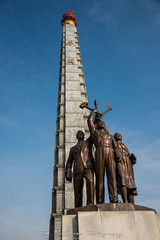 Communist revolutionary statue but the Juche Tower in Pyongyang, North Korea (DPRK) (tommcshanephotography) Tags: adventure asia communism dprk democraticpeoplesrepublicofkorea expedition exploring kimilsung kimjungil kimjungun northkorea pyongyang revolution secretcompass travel trekking