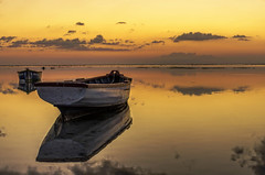 Quiet...Lagoon (Malaquin Eric ........ thanks for your visits & co) Tags: mauritius indianocean ilemaurice sea fishingboat reflection endoftheday ericmalaquin 35mm atmosphere clouds lagoon lagon light goldenhours water coucherdesoleil colors crepuscule cloud pentax seaside seascape sky sundown panoramicphoto fishingboats