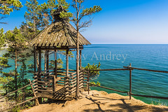 Old wooden gazebo (Ivanov Andrey) Tags: gazebo fence roof bench view vacation lake water rock cliff slope shore stone pinetree sand bay surf wave sky cloud horizon sun sunset evening stem branch bark moss therootofthetree wind coast coastline landscape shade wildlife travel tourism summer north lakebaikal russia