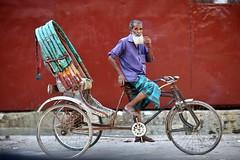 So, you think I'm cute ? (N A Y E E M) Tags: rickshawwalla colors cigarette smoke break afternoon street chatteshwariroad chittagong bangladesh carwindow