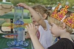 King of Kerplunk (Pejasar) Tags: kerplunk crown birthdayparty grandson granddaughter park picnictable game intense new present color boy girl play