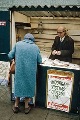 London News (sindit) Tags: london newspaper moorgate 1975 europe 70s tube station crash train press papers newspaperstand kiosk uk england lesleywhittle march eveningnews eveningstandard dailymail donaldneilson blackpanther lemonde nikonf2 28mm coolscan ved ls50 news kodachrome slide film kidnapping abduction heraldtribune newspapers seventies victims derailment fleetstreet tabloids disaster disasters oldlady street urban city nikkor londra londinum britain gb elderly kienholz underground railway headlineposters headline headlines newspapervendor