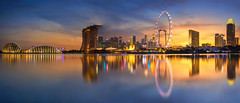 Singapore Skyline. Singapore `s business district (anekphoto) Tags: marina bay flyer view top business port sunset bright roof asia tourism river travel quayside illuminated locations contemporary skyline bank sun architecture sea financial museum cityscape skyscraper downtown saturated waterfront logistic urban landmark centre holiday built singapore district place sands famous science city boat scene office toned structure asian