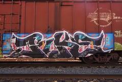 PIKE (TheGraffitiHunters) Tags: graffiti graff spray paint street art colorful freight train tracks benching benched pike boxcar