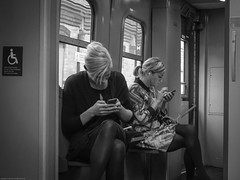 Disabled by their phones? (judy dean) Tags: train women wheelchair journey disabled phones absorbed 2015 judydean sonya6000