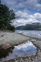 Bonnie Banks (Neillwphoto) Tags: trees sky mountains reflection beach pool clouds rocks stones pebbles hills shore lochlomond