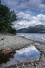 Bonnie Banks (Neillwphoto) Tags: trees sky mountains reflection beach pool clouds rocks stones pebbles hills shore lochlomond