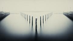 Mölle - ellöM (claustral) Tags: bw cold reflection water monochrome mirror skåne sweden harbour toned flickrmeet kullaberg pilons mölle interestingness77 i500 kullen100327 explore051122