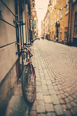 The missing bulbs (Sator Arepo) Tags: christmas street urban bike bicycle canon vintage europe sweden stockholm bulbs 5d 24mm leaning narrow tse markii tiltshift pavestones