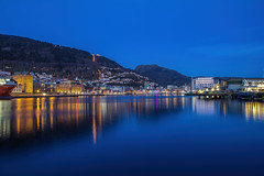 My hometown - Bergen (Siggi007) Tags: bergen blue bluehour longexposure le midnight evening city cityscape fjord sea water buildings mountains mountainsides nature lights reflections reflection ship sky houses living town tranquil mood canon view beautiful winter exposure eos europa travel urban outdoor panorama abend scenery scandinavia seaside scene dawn farben landscape landschaft colors colour norway norwegen noruega nacht night waterfront pier architecture