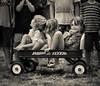 Radio Flyer (Philocycler) Tags: canon canoneos5dmarkiii ef50mmf14usm childphotography radioflyer wagon children smile happy admiration fun kids
