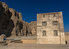 Tourists in front of the tower knows as the kabah of zoroaster in naqsh-e rustam necropolis, Fars province, Shiraz, Iran (Eric Lafforgue) Tags: 9people achaemenid ancient antique antiquities archeology architecture brick cliff colorimage cube darius day history horizontal iran iranianculture kabah landmark men middleeast naqsherostam naqsherustam necropolis oldruin outdoors perseus persia photography rock royaltombs rustam shiraz smallgroupofpeople temple tourism touristic tourists traveldestinations unescoworldheritagesite women zoroastrian farsprovince