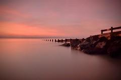 Morning has Broken (hall1705) Tags: morninghasbroken sunrise dawn pink groyne rocks longexposure westsussex water sea seascape seaside seadefence felpham d3200 sky nature outdoor calm beacheslandscapes