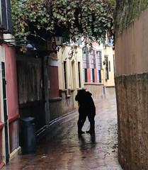 a kiss in Siviglia (xiaolifra) Tags: shadow siviglia walking espana spain lights chance portraits picoftheday photo moment time bridge amazing colorful dark blackwhite black simply emotions
