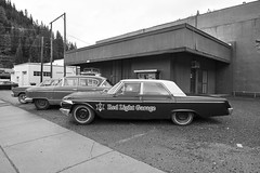 Red Light Garage (Curtis Gregory Perry) Tags: wallace idaho old car ford nash ranchero statesman black white bw 1964 1956 automobile vintage classic parking lot nikon d800e red light garage
