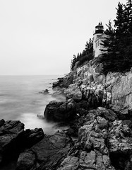 Black and White Light (Jonathan Miske) Tags: acadianationalpark architecture atlanticocean bw bassharborheadlighthouse blackwhite blackandwhite bluffs canon canon6d canoneos6d cloudy coast day landscape lighthouse longexposure maine motionblur mountdesertisland newengland ocean rain rocks seascape summer tamron2875mmf28xrdildasphericalifa09 usa unitedstates water tremont