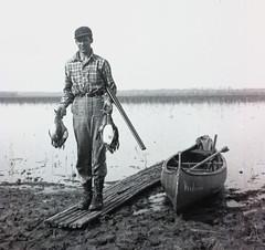 Duck Hunting (Sherlock77 (James)) Tags: people man duck rifle canoe oldphoto foundphoto vintagenegative