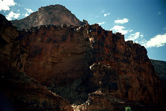 35-071 (ndpa / s. lundeen, archivist) Tags: nick dewolf nickdewolf color photographbynickdewolf 1970s 1973 1972 film 35mm 35 reel35 arizona northernarizona southwesternunitedstates canyon marblecanyon grandcanyon coloradoriver raftingtrip raftingexpedition rafting river riverrafting mountains canyonwall canyonwalls sky bluesky clouds rock rocks rocky cliff cliffs